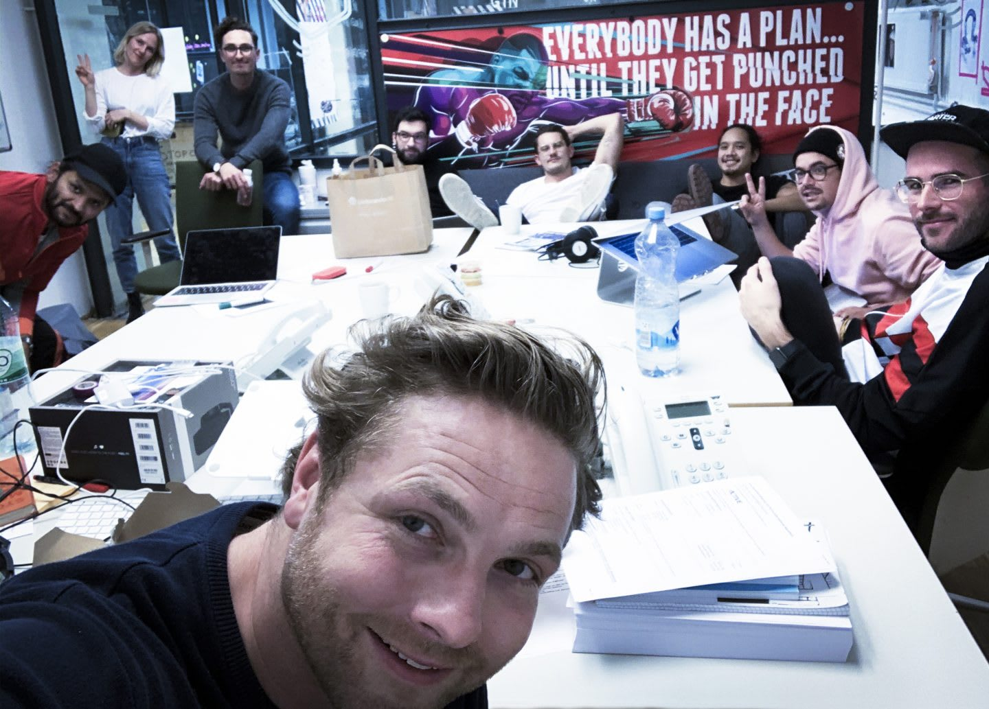 Selfie of a group of people in a conference room. How to build a creative workplace culture, JvM, workplace, collaboration, creativity, team-building, GamePlan A