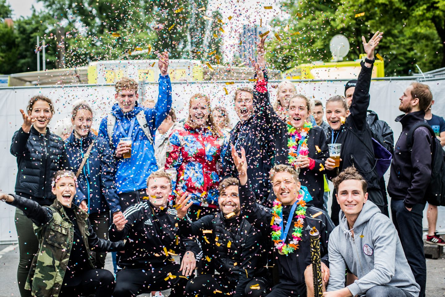 Group photo with people throwing confetti in the air. How to build a creative workplace culture, JvM, workplace, workplace culture, creativity, GamePlan A