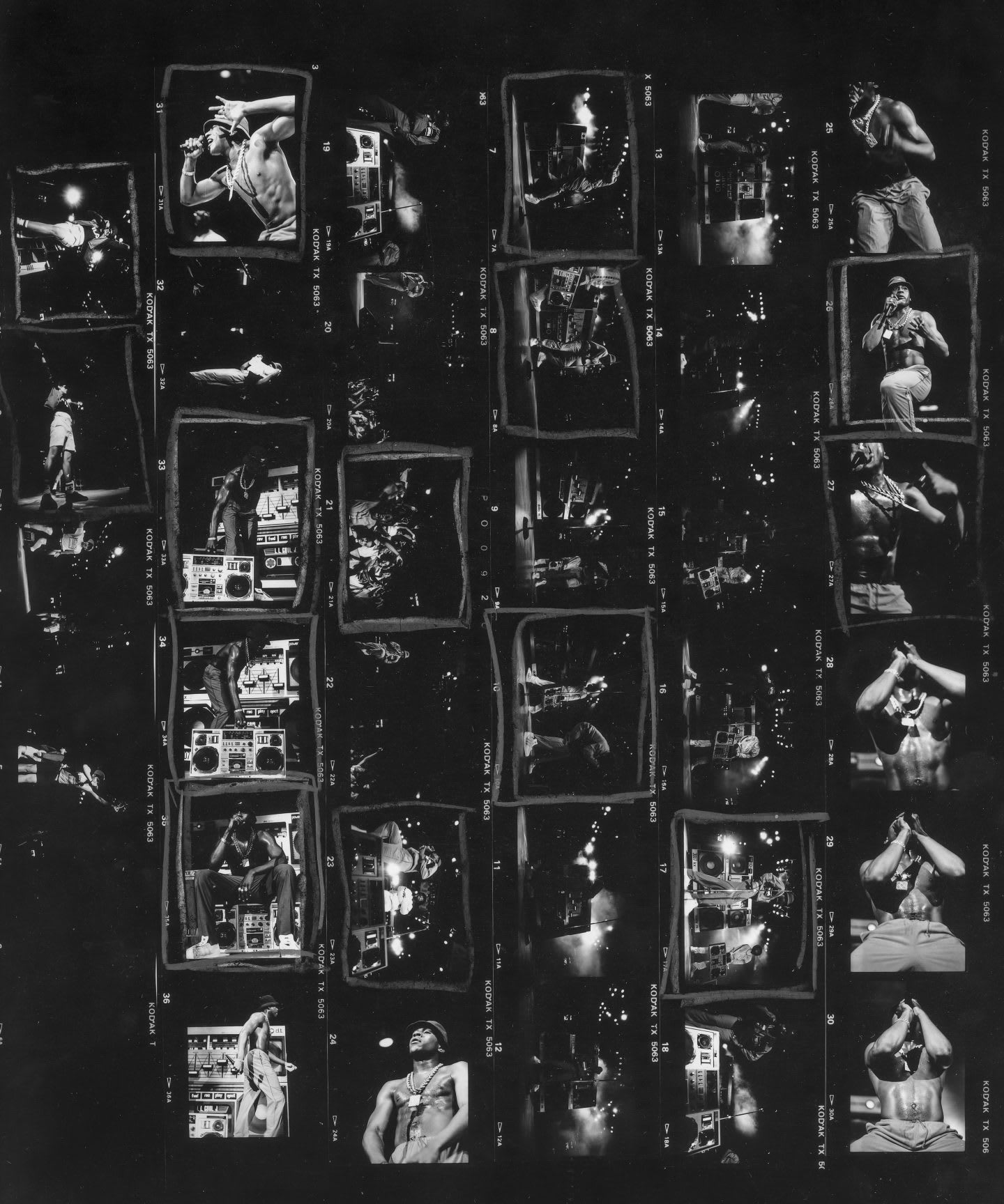 A black and white contact sheet shows images from a Run DMC concert.