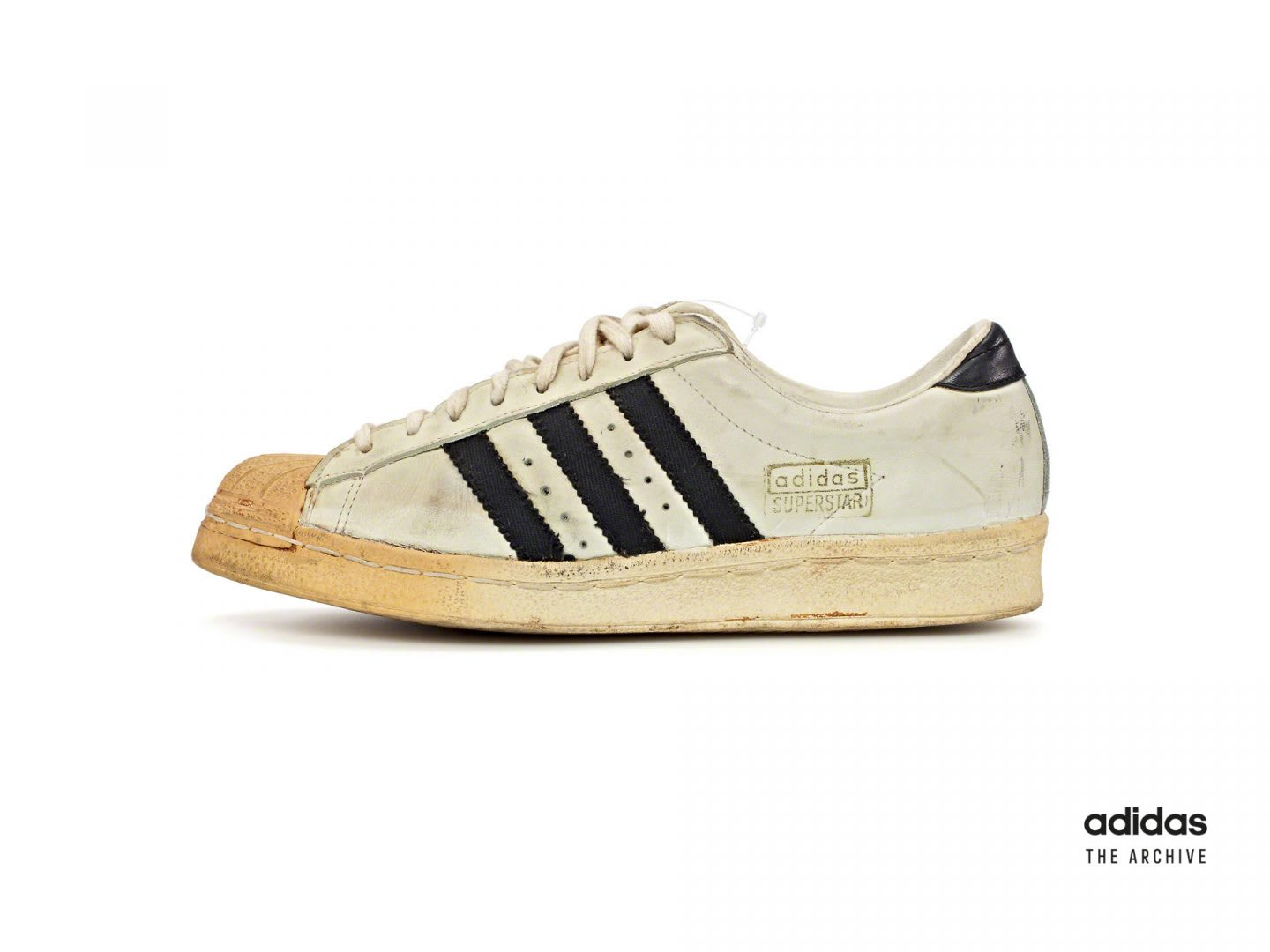 Image of one of the original adidas Superstars in white and black.