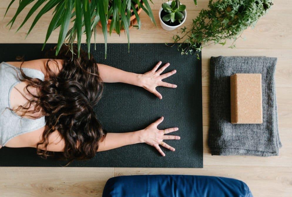 Woman doing a Yoga posture. GamePlanA, BusinessWithPurpose