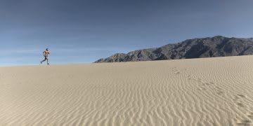 a man running alone in the desert