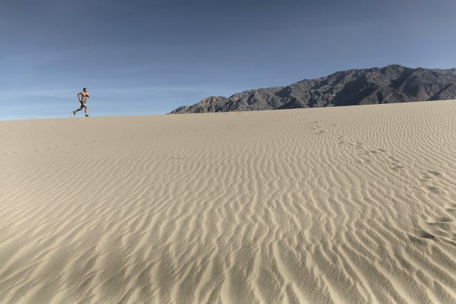 a man running alone in the desert