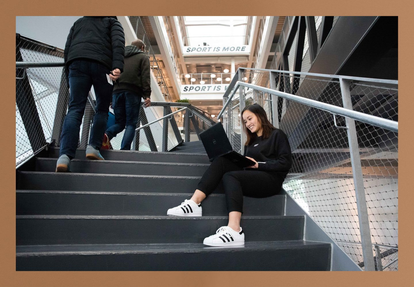 Thui Bui sitting in the starts of the adidas HQ working. Be Unique, self development, personal growth, GamePlanA