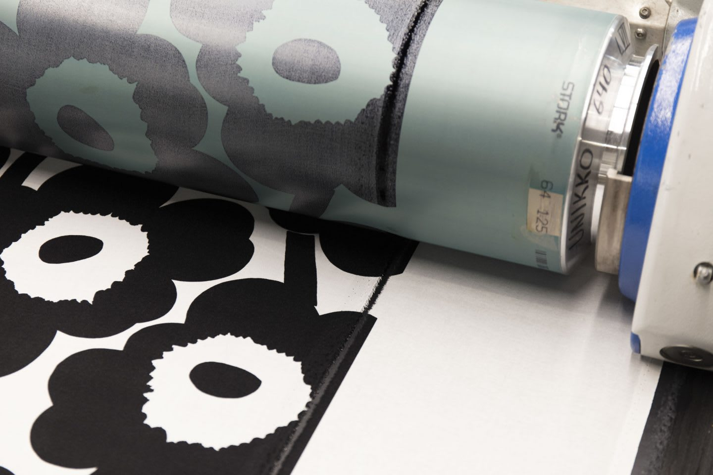 Printing machine at Marimekko's production center and a black pattern. Marimekko, floral design, GamePlanA