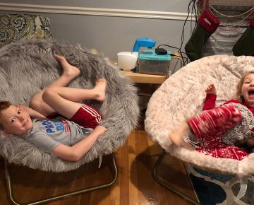 Two children lying on two lounge chairs, managing stress, parenting, health, habits and routines