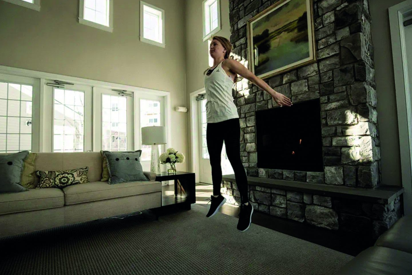 Girl jumping during workout at home, home office, workout, fitness, sports, strength, training, GamePlan A