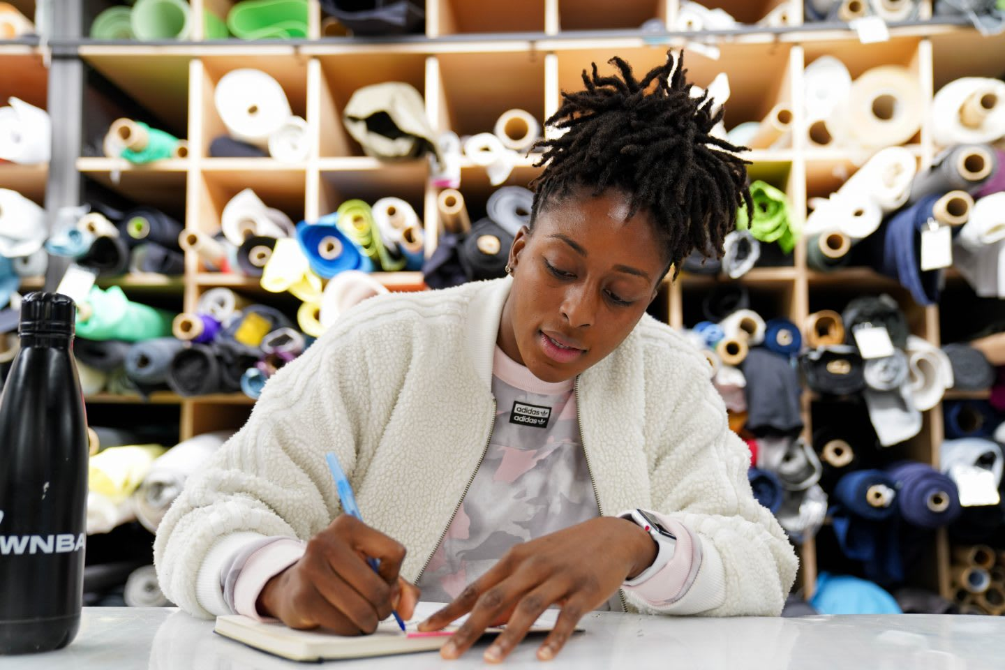 WNBA player Nneka Ogwumike writing ideas in notebook, adidas, office, creativity, work, ideas, GamePlan A