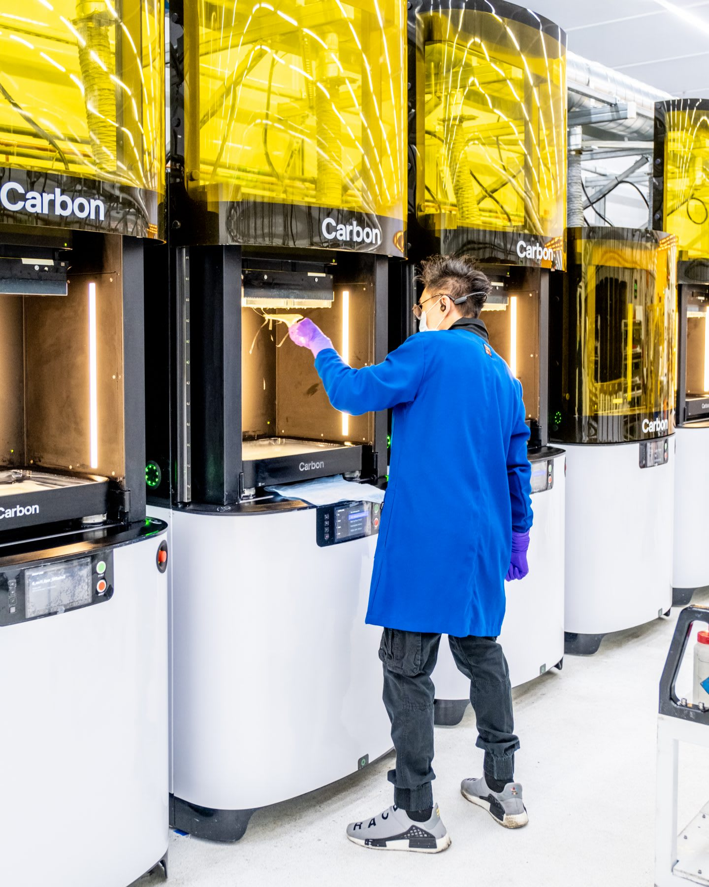 Carbon employee during the 3D printing process of face shields. Carbon face shields, GamePlanA