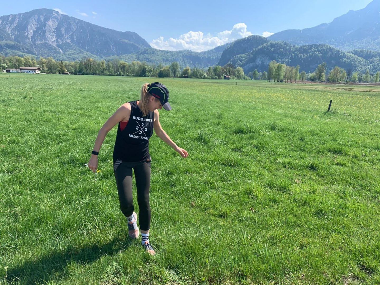 Women running through a green field in a mountain landscape. running communities, running, runtastic, athlete mindset, motivating the team, collaboration, GamePlanA.