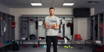 The Captain of Bundesliga Club Union Berlin standing in the middle of an empty locker room. Union Berlin, Leadership Skills, Achieving Success.
