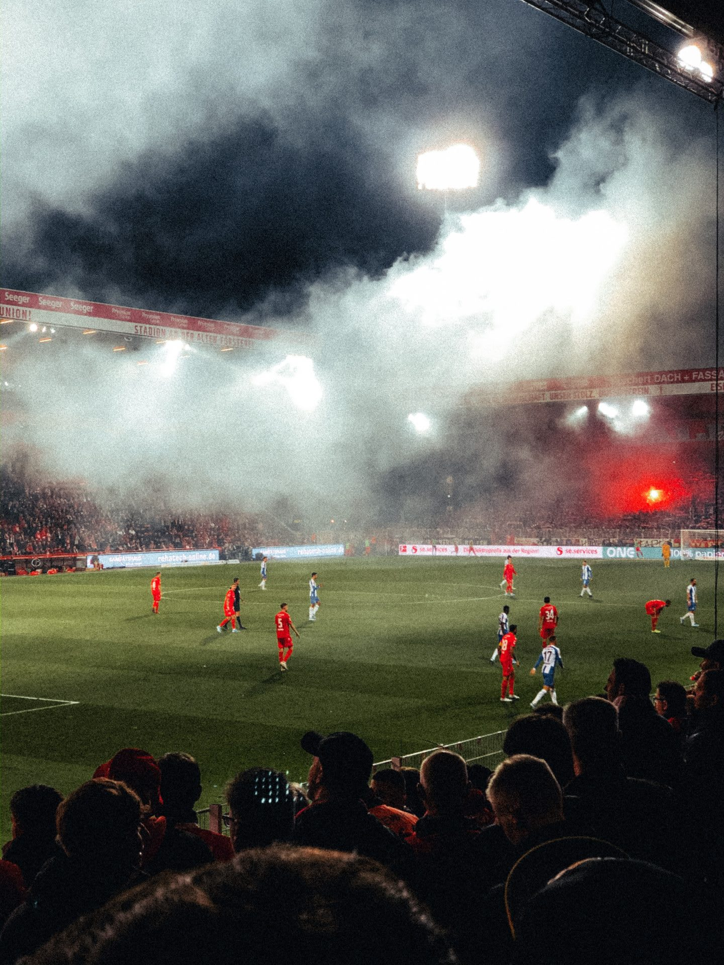 Photograph picturing the atmosphere in the Stadium of Bundesliga Club Union Berlin during a game under floodlight.