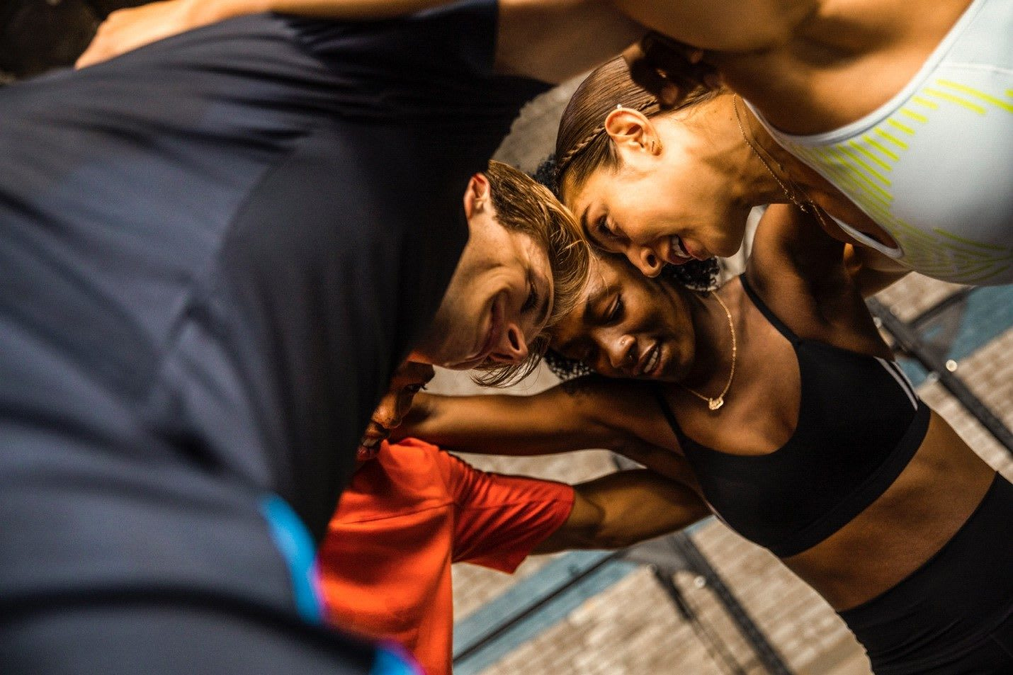 Men and women training indoors. accountability partner, GamePlanA