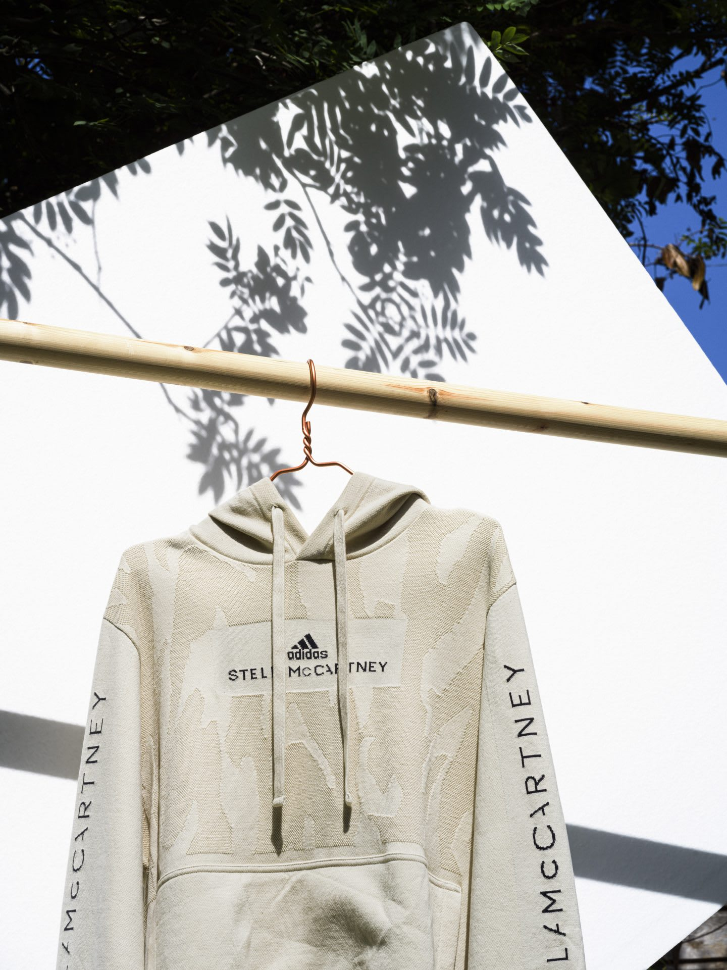 A white adidas by Stella McCartney hoodie hanging on a clothes rail. plastic waste, Stella McCartney, adidas, infinite hoodie, GamePlan A