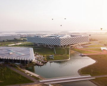Big architectural buildings in open space with a lake in between at sunset, adidas, campus, HQ, Arena, Halftime, buildings, Herzogenaurach