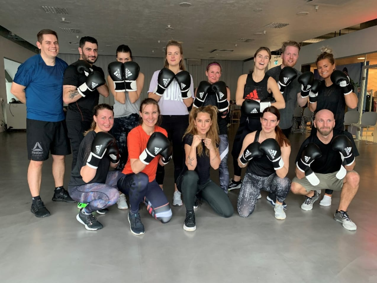The adidas Nordics team in a group picture after a Night Fight class with Alexandra Pizzoni. Self-Care, adidas, Training, Workout, healtyish, GamePlanA.