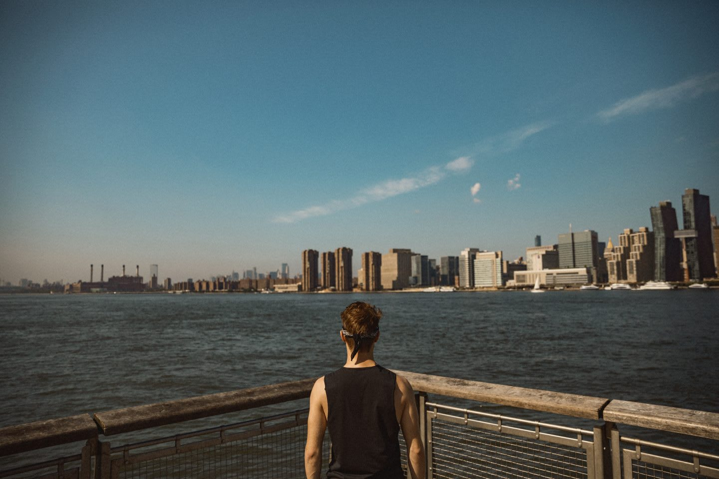 Man in sports clothes looking out at the ocean with skyline in the horizon, view, mindset, mindfulness, thinking