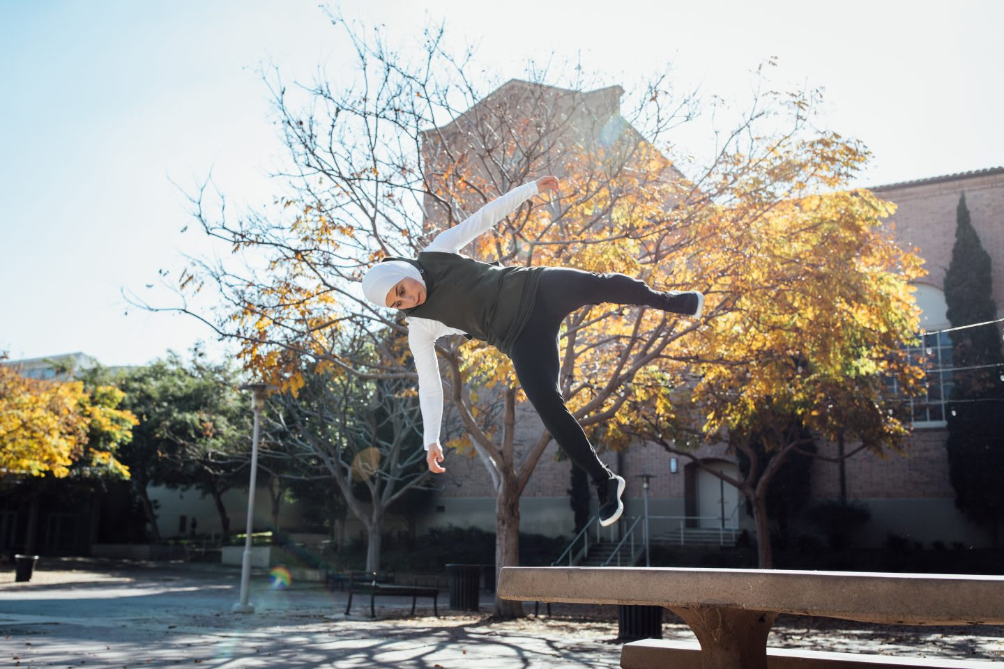 Girl doing flip in the air on a sunny day, parkour, sports, action, fitness, exercise, Sara Mudallal