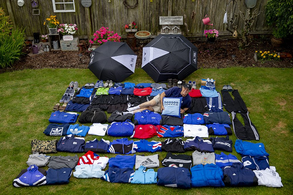 Man lying in a pile of adidas clothes, superfan, adidas, Grand B, Bruce Benson