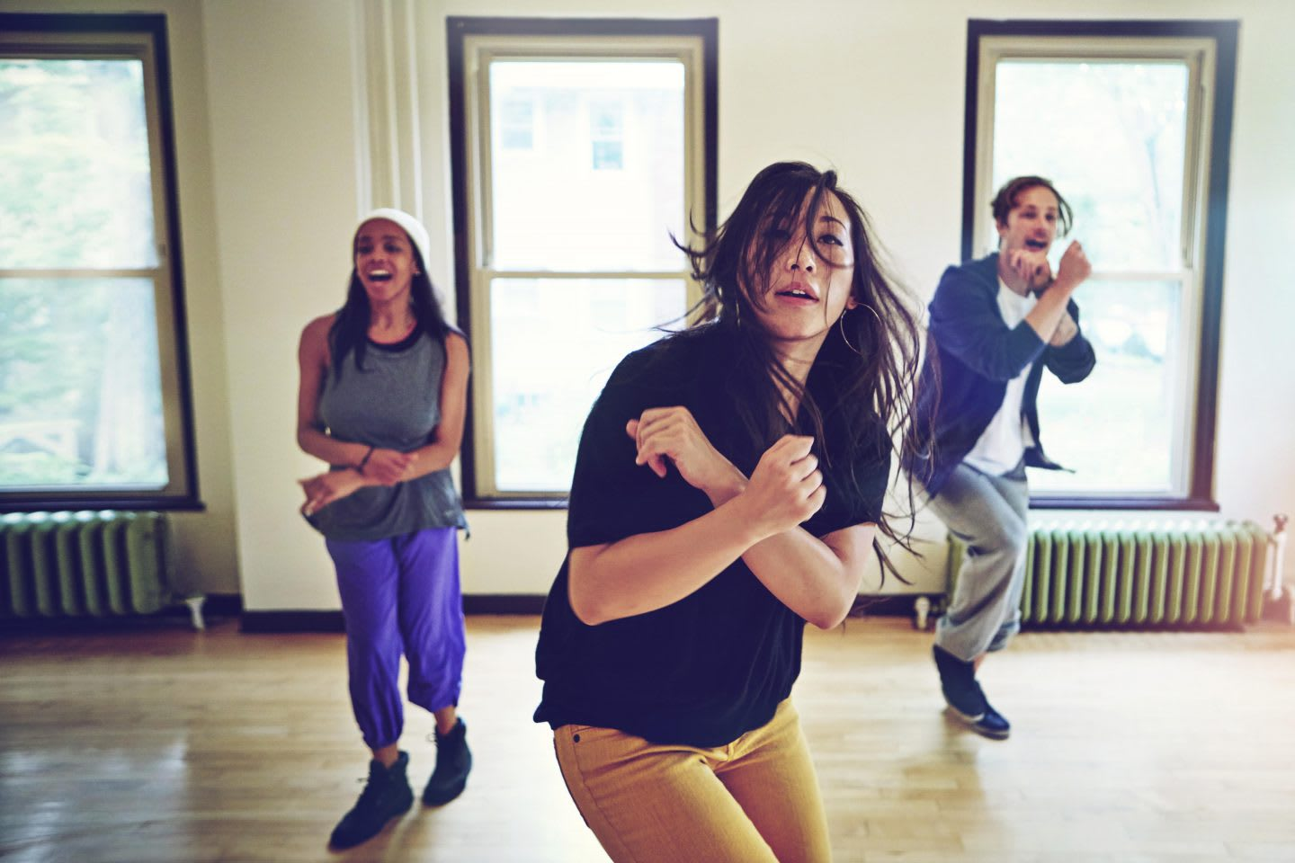 Three people dancing in a dance studio, friends, music, movement, active, fun