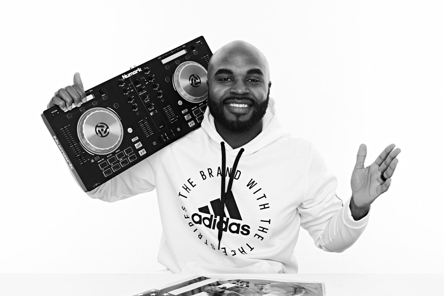 Man wearing adidas hoodie posing with a boombox on his shoulder, music, DJ, creator, creativity, Aaron Limonthas, adidas, employee