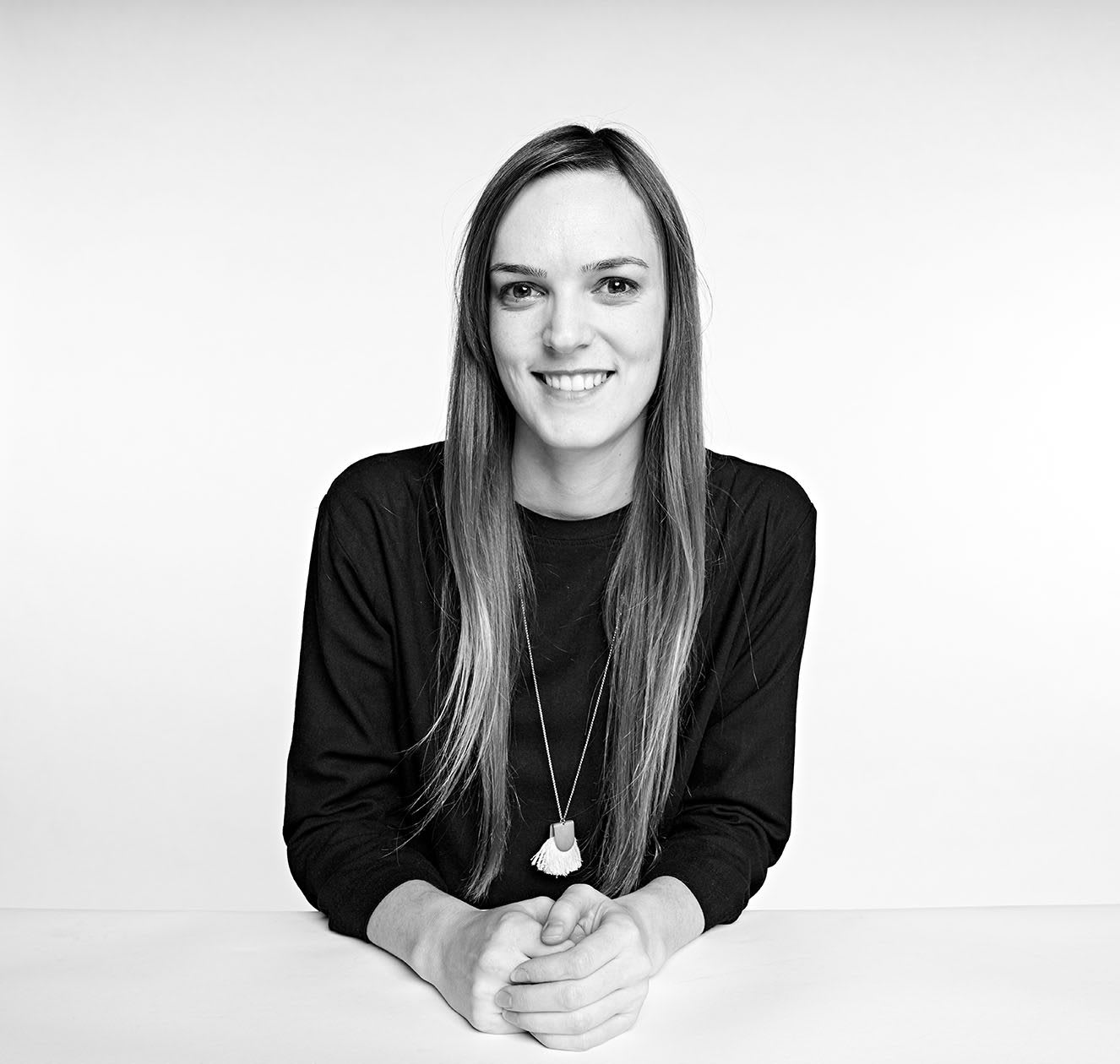Woman smiling smiling in a black and white portrait picture, Brandi Cox, adidas, employee