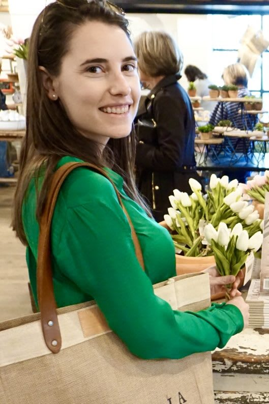 Woman smiling with a handbag while holding a bouquet of flowers, girl, lady, Stefanie Berenguer, adidas, employee