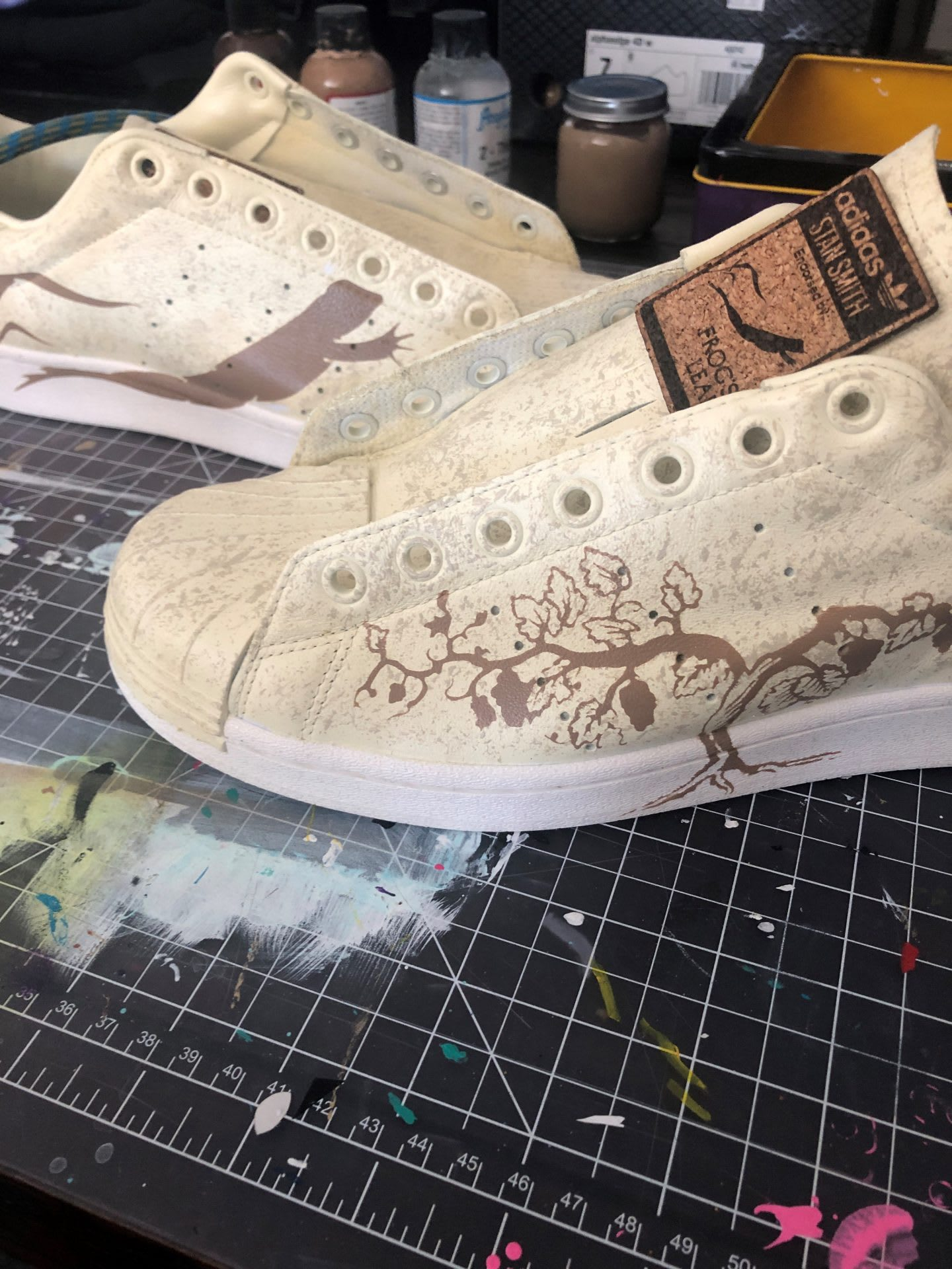 Cream colored sneakers customized with bespoke patterns, design, shoes, trainers, sneakers, Todd Standsbury, creative, adidas, employee
