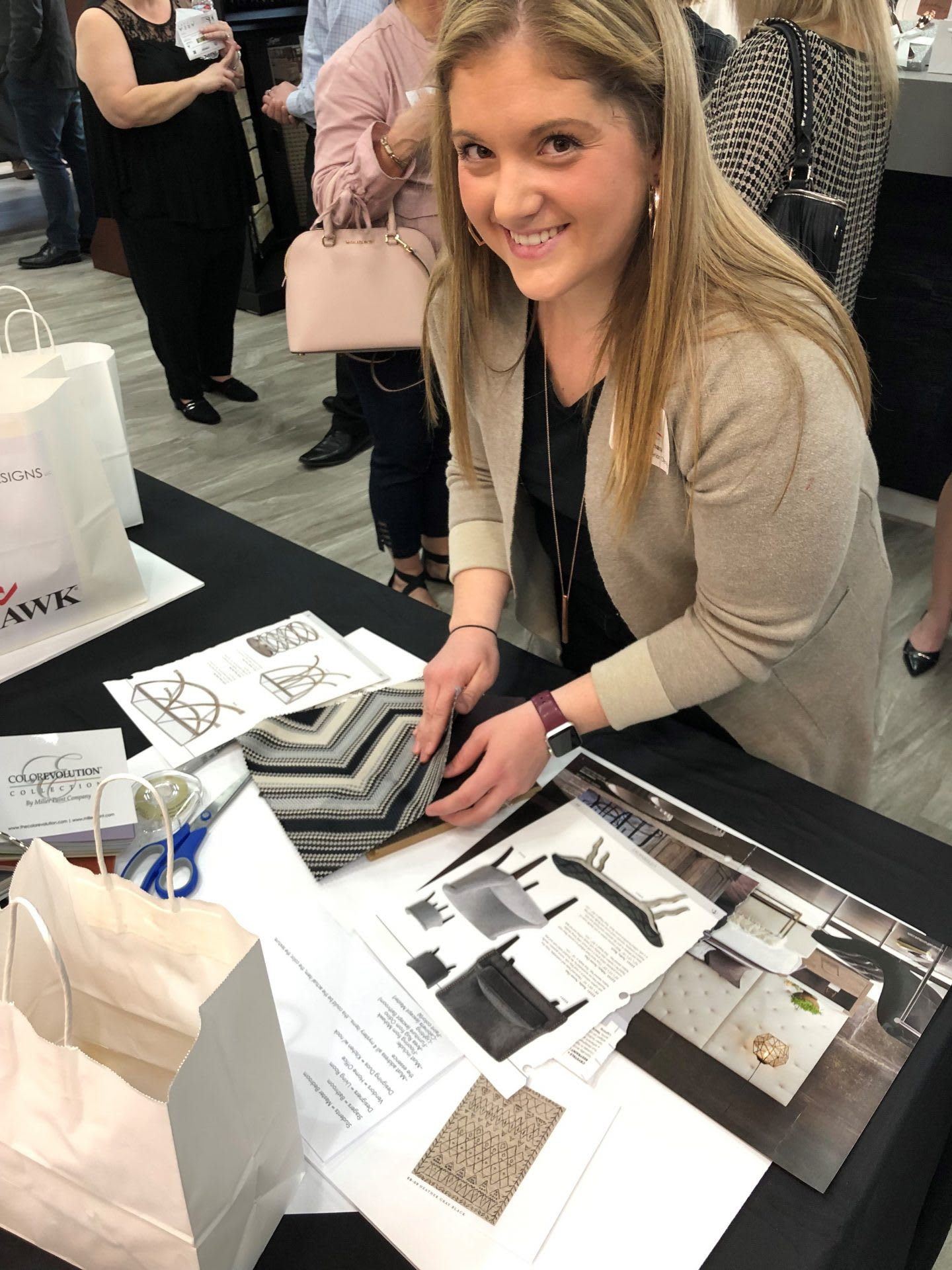 Woman smiling while looking at fabric samples for furniture, interior designer, creativity, Brandi Cox, adidas, employee