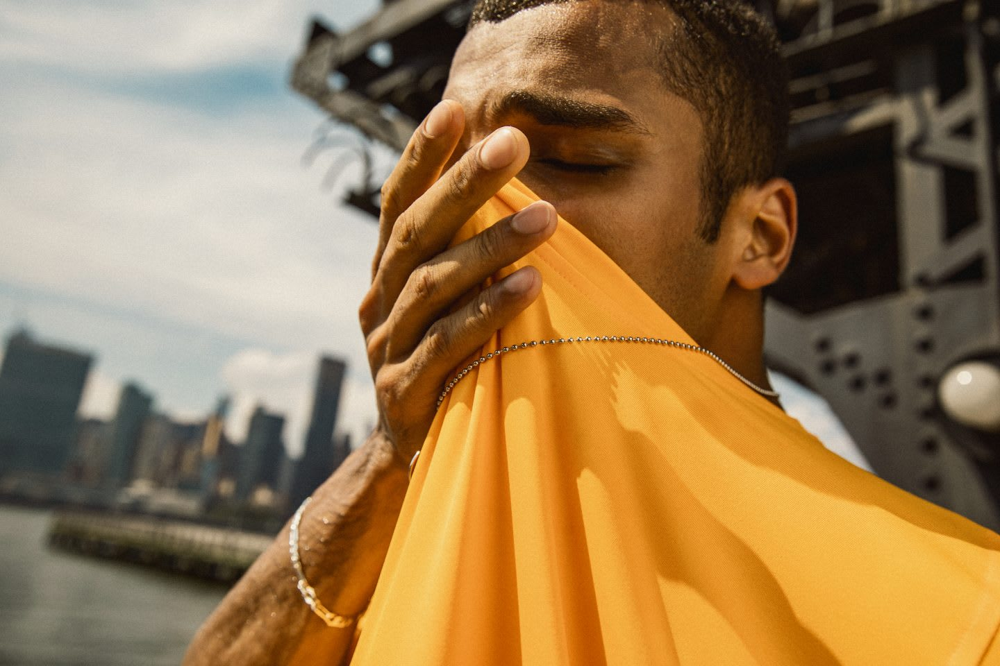 Man wiping sweat off his face with a yellow t-shirt after exercise, sport, fitness, performance, rest, GamePlan A, adidas