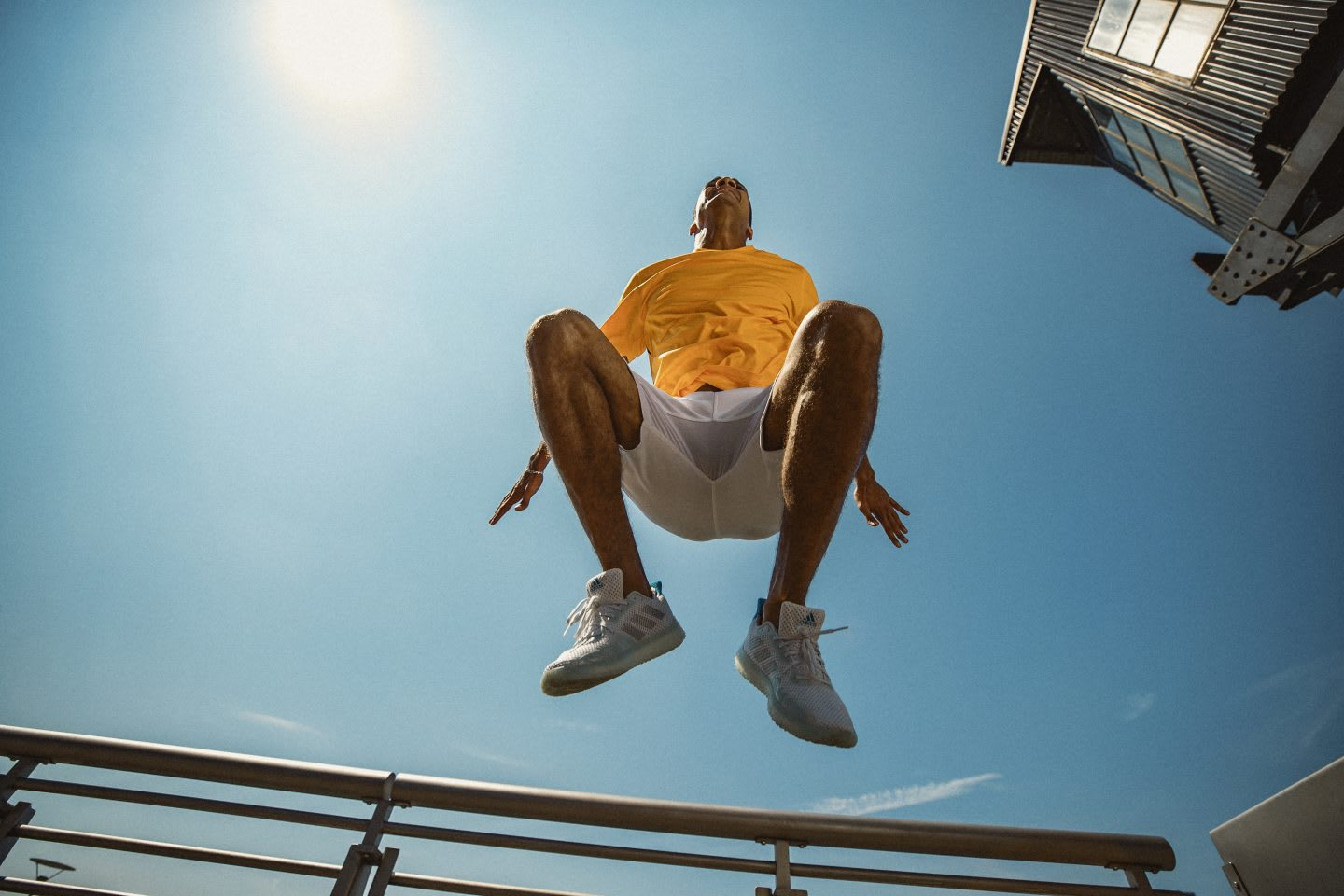 Man in yellow shirt jumping during sport, exercise, fitness, adidas, GamePlan A