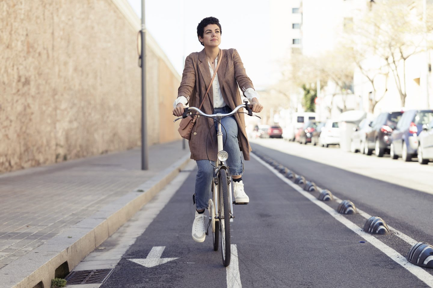 Woman with bike on bicycle lane in the city, commuting, biking, bike, cyclist, cycling