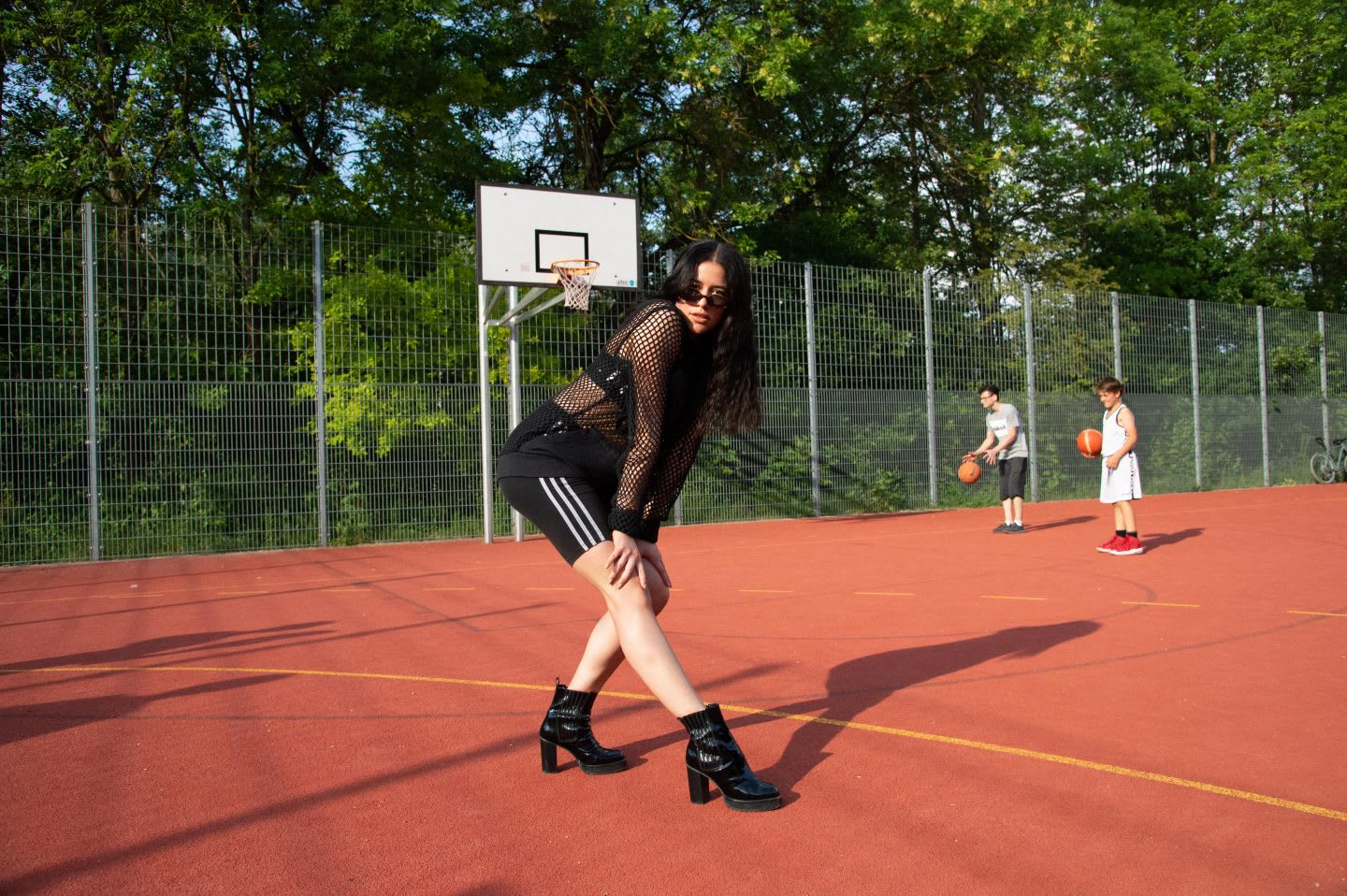 Girl wearing black tights and black boots posing on a basketball court, voguing, vogue, photography, attitude, posing, adidas, employees, confidence, GamePlan A