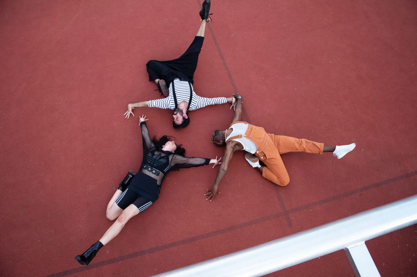 Two men and one woman lying on the ground with dramatic poses, voguing, vogue, photography, attitude, posing, adidas, employees, confidence, GamePlan A