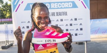 Kenyan long-distance runner holding the adidas adizero adios Pro after the Prague half marathon, adidas, athlete, runner