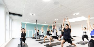 Men and women doing yoga poses during a yoga class at a gym, GYM, Herzogenaurach, adidas, employees, workplace, fitness. sports, culture, active, health, lifestyle