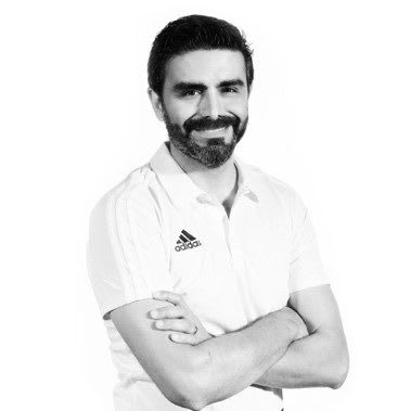 Man with beard and moustache smiling at camera with arms crossed, Salvador Mothe, adidas, employee
