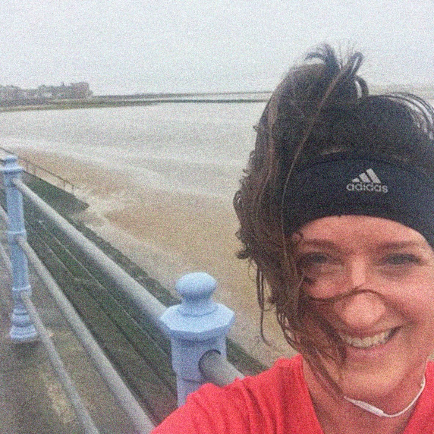 Woman smiling with adidas headband during run at Morecambe Bay, running, 1000, miles, sport. fitness, employee, adidas