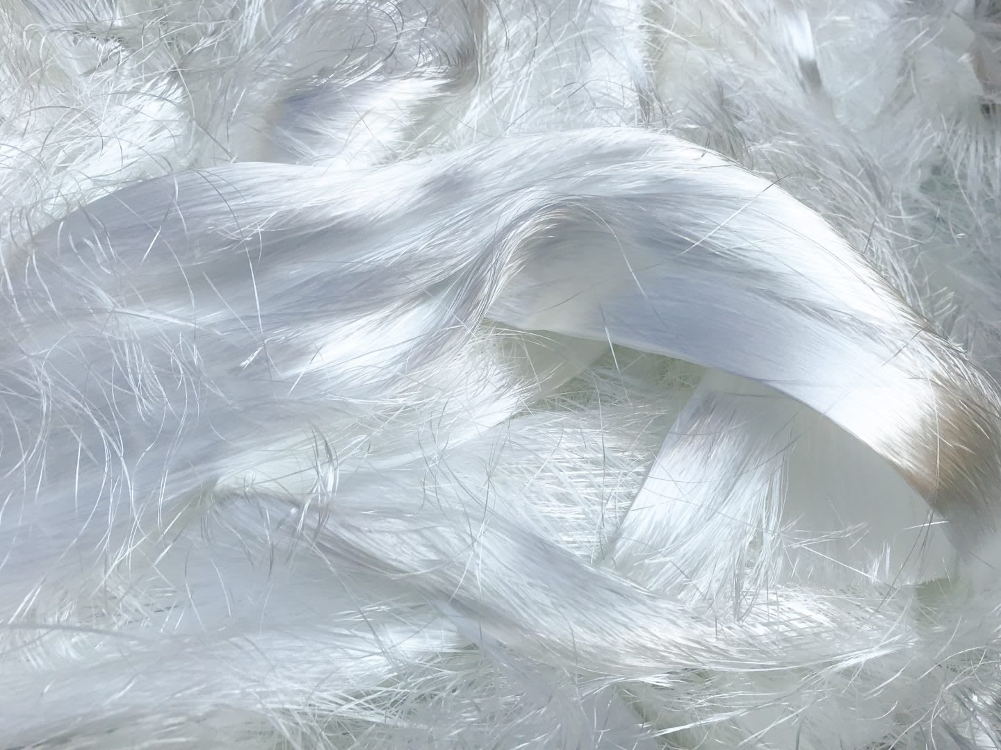 White polyester fibers tangled together, plastic, material, innovation, sustainability, mono-material, adidas