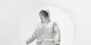White winter jacket disintegrating into the air on a white background, FUTURECRAFT, LOOP, Anorak, sustainability, recycle, material, adidas, remade