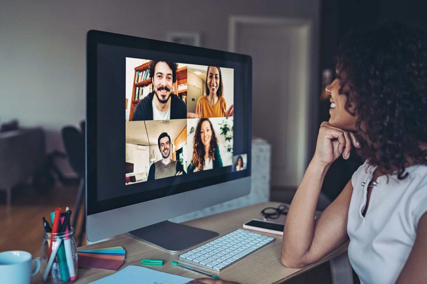 Group of people having a video conference through a desktop computer, remote working, home office, digital, technology, team, connection, online, meeting, business