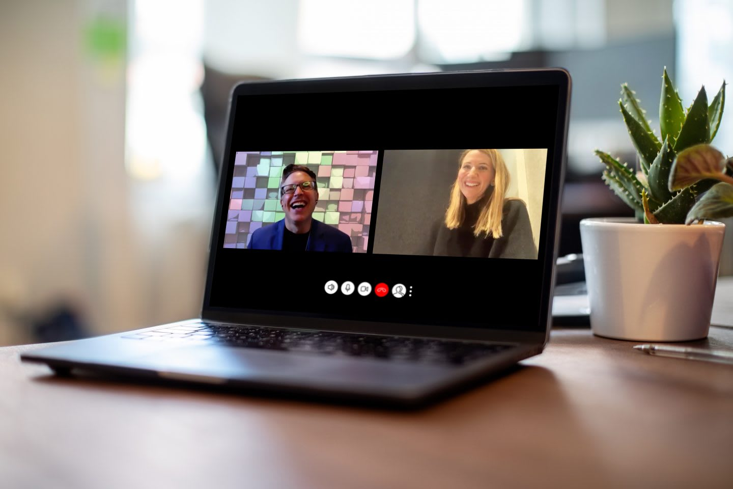 Man and woman having a video call on a laptoWoman having meeting on video call on laptop, connection, technology, meeting, collaboration, teamwork, Aimee Arana, Ronald Beghetto, adidas, LEGO