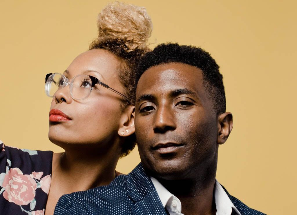 Man and woman posing stylishly while looking at the camera, podcast, race, inclusion