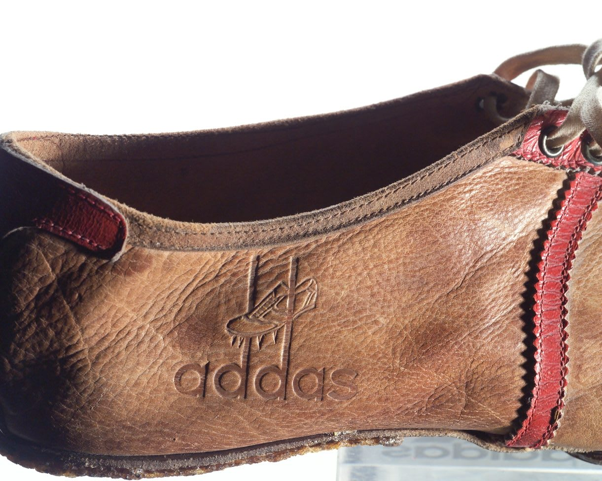 Old fashioned leather running spikes with addas logo embossed on the side, Adolf, Dassler, Adi, adidas, sports, shoes, shoemaker, history, archive