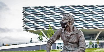 Statue of adidas company founder Adolf Dassler in front of the company headquarters in Herzogenaurach, Germany, mask, coronavirus, pandemic, safety