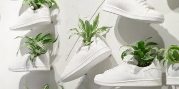 White shoes attached to white wall with plants growing inside, London, Carnaby, Originals store. flagship, sustainability, 3D