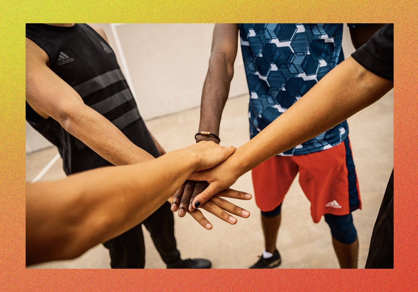 Group of people joining hands together in a circle, teamwork, team, inclusion, group, diversity, adidas