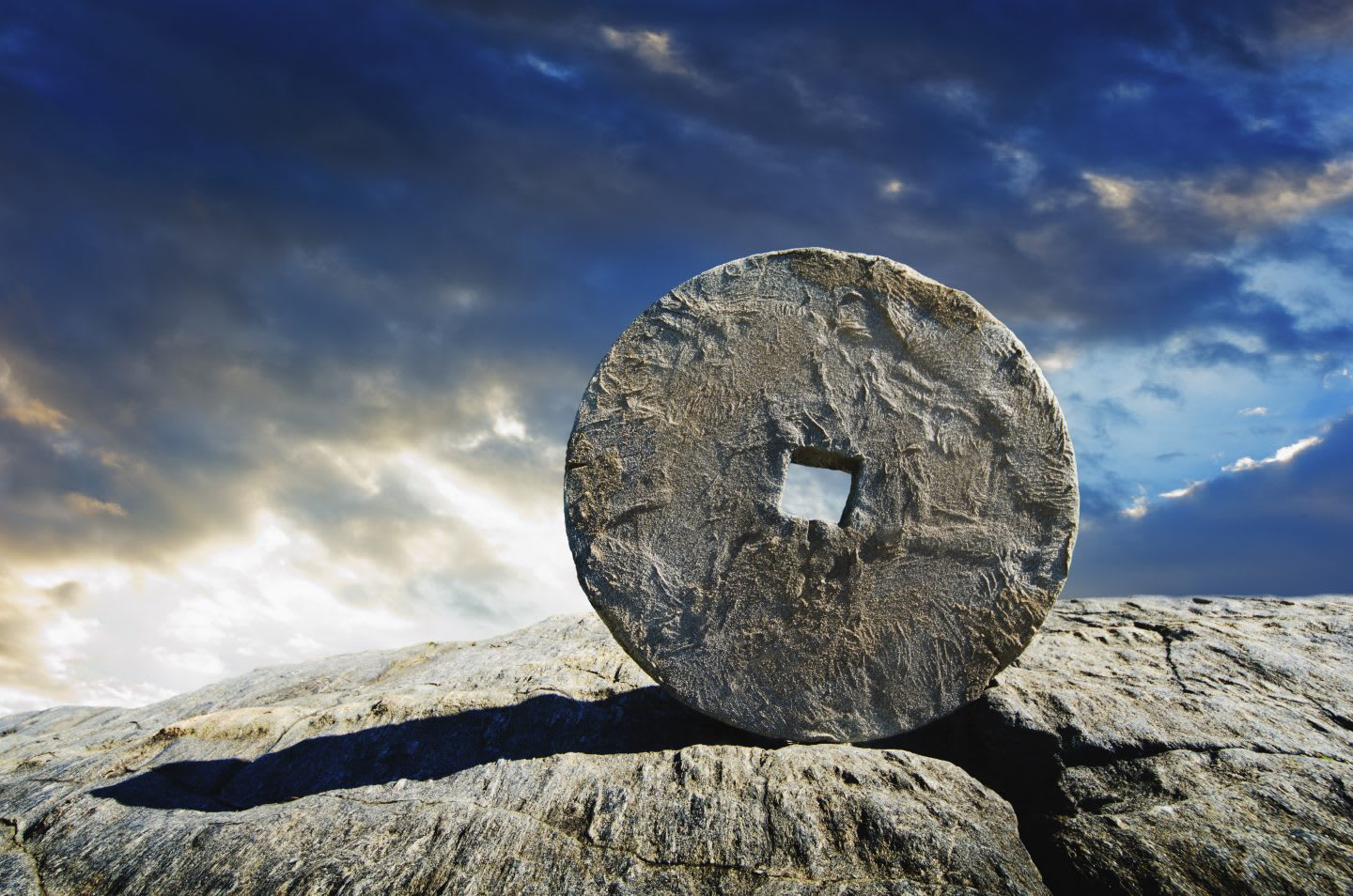 Ancient stone circle artefact against a blue sky background, USA, New York City, ancient, stone, circle