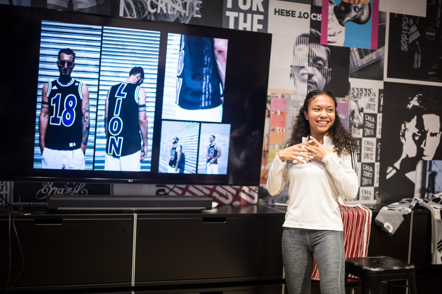Girl presenting clothes in front of team at work, adidas, Brooklyn Creator Farm, NYC, New York City, designer, entrepreneur, Kim Aponi, GamePlan A