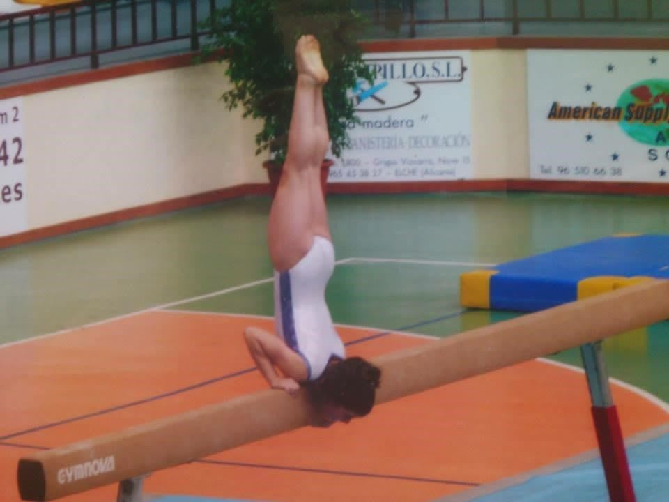 Girl balancing on a high beam during gymnastics practice, balance, sports, focus, practice, Sara Baeza